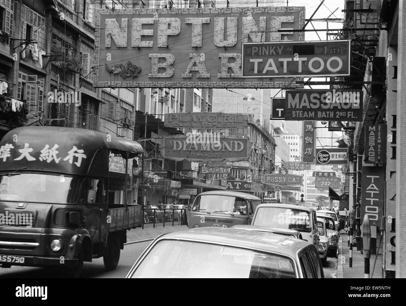 Traffic and signs advertising night clubs, tattoo and massage parlours seen here on Lockhart Road, Wanchai, Hong - Stock Image