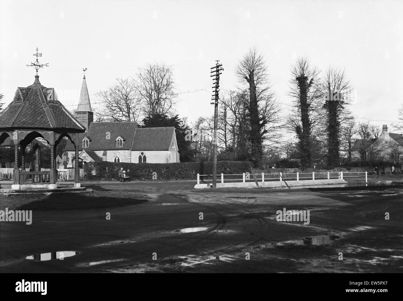 St Giles church at  Ickenham, London, in the fore ground is the village pump Circa 1930 - Stock Image
