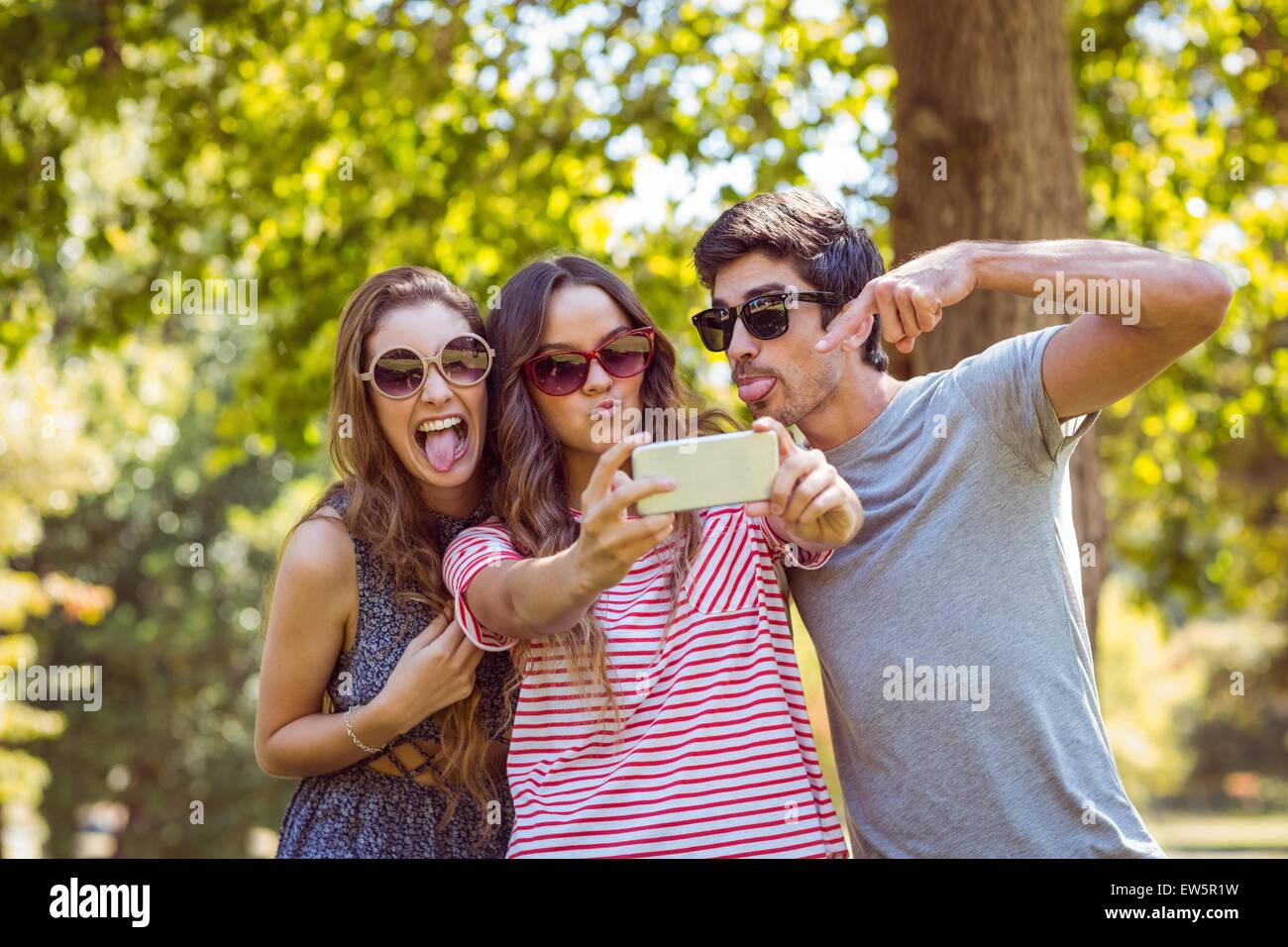 Happy friends taking a selfie - Stock Image