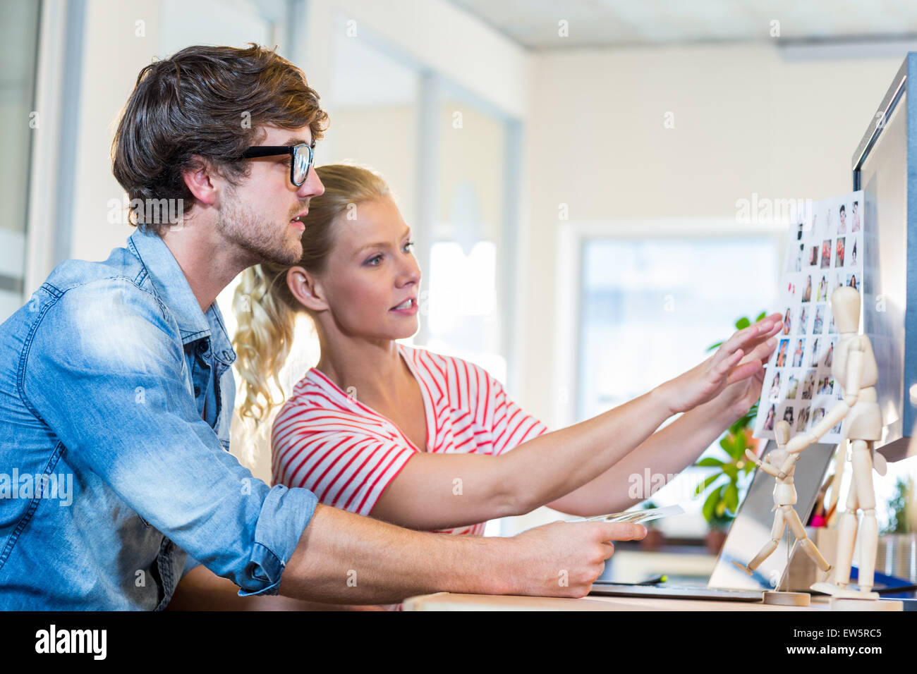 Professional designers working on photos - Stock Image