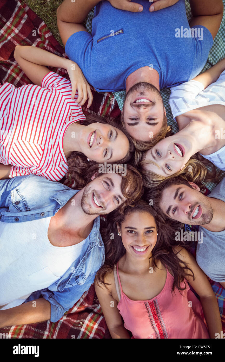 Happy friends in the park huddling in cirlce - Stock Image