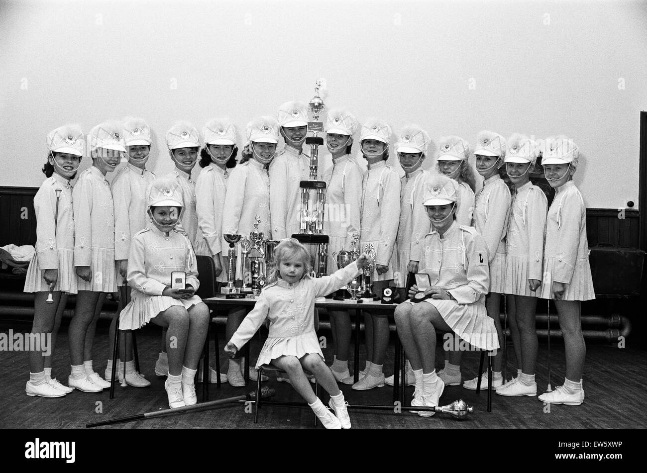 Member of a recently formed majorette troop are literally in the limelight after winning a top trophy at a seaside - Stock Image