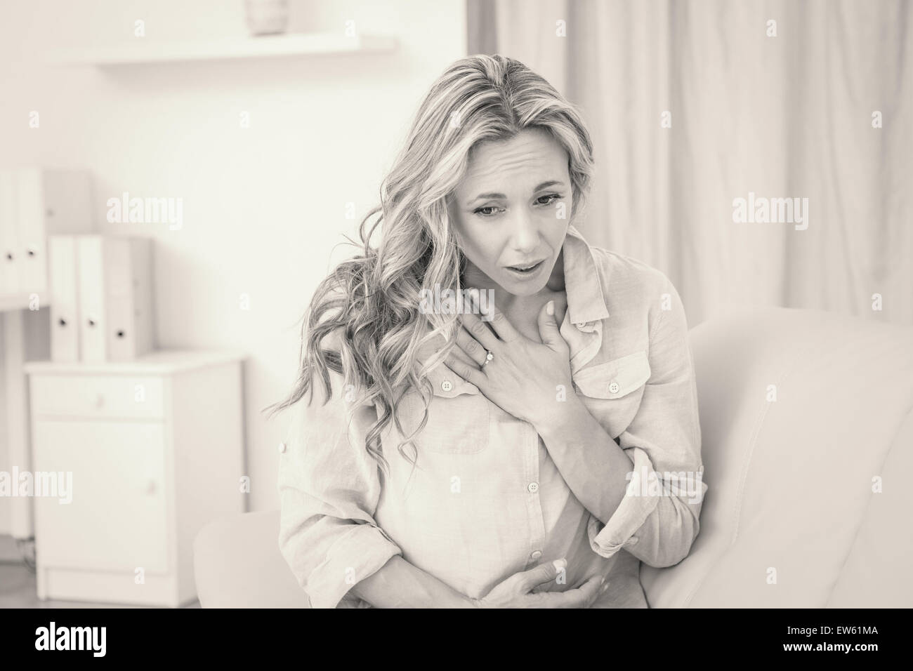 Pretty blonde getting affliction breathing - Stock Image