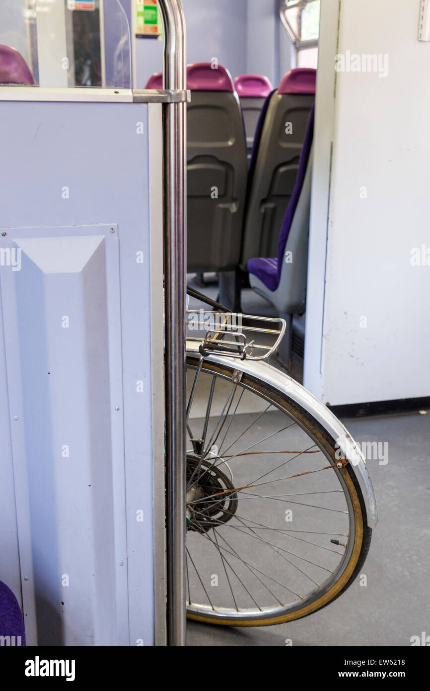 Bike on a train with back wheel sticking out into the corridor causing an obstruction, England, UK - Stock Image