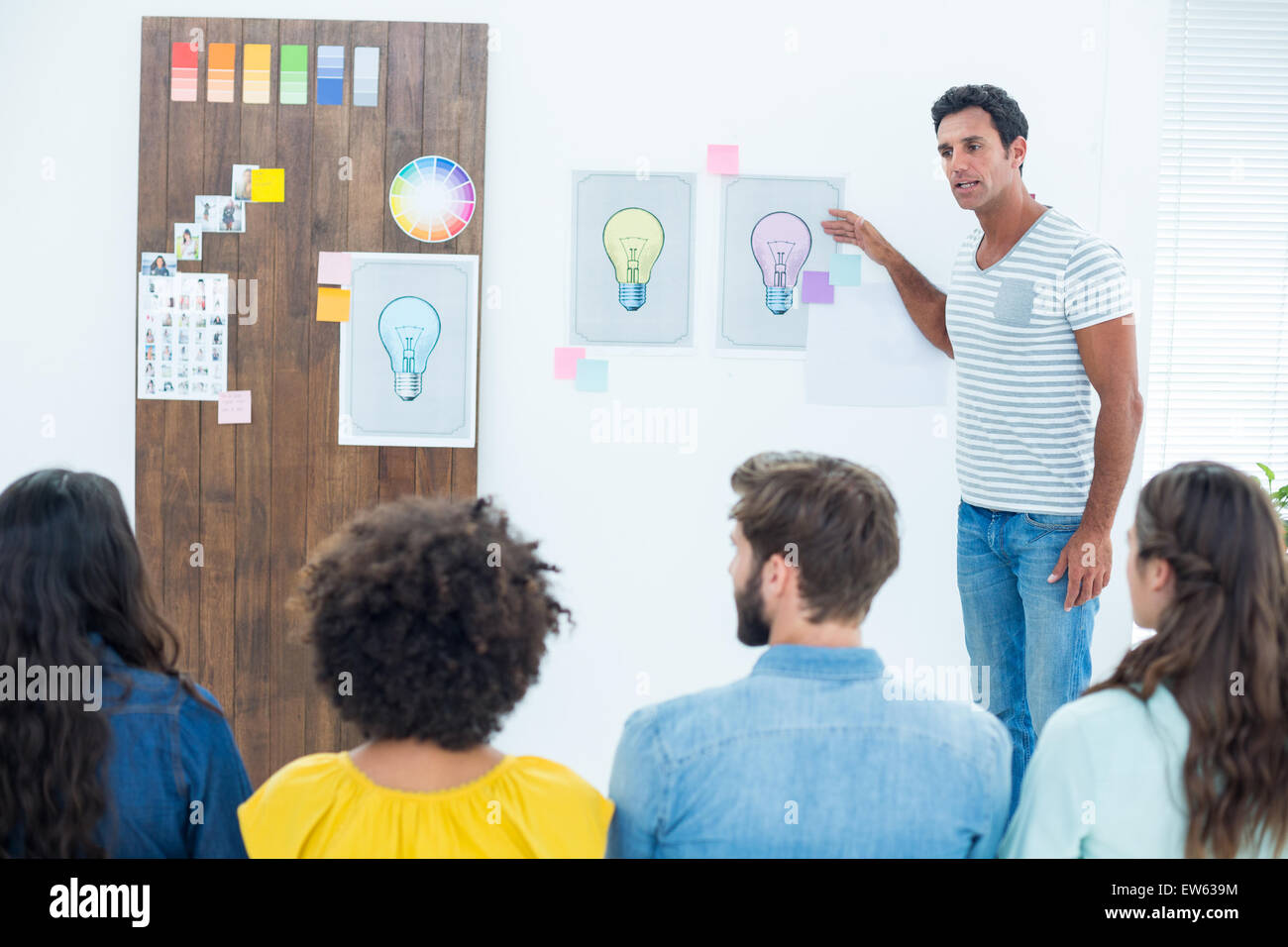 Creative business people at work by blackboard - Stock Image