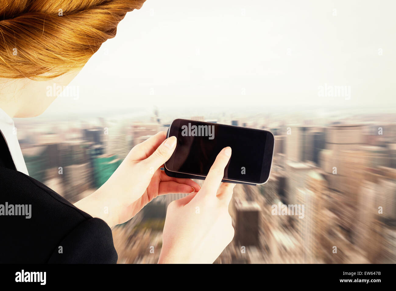 Composite image of businesswoman holding smartphone showing screen - Stock Image