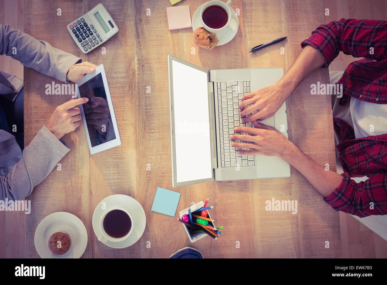 Creative businessmen working on electronic devices - Stock Image