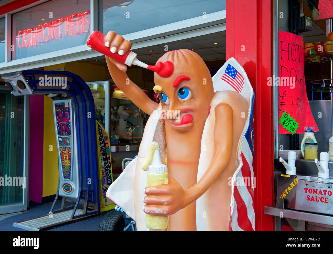 Kitch figure outside hotdog stand, Bridlington, East Yorkshire, England UK - Stock Image