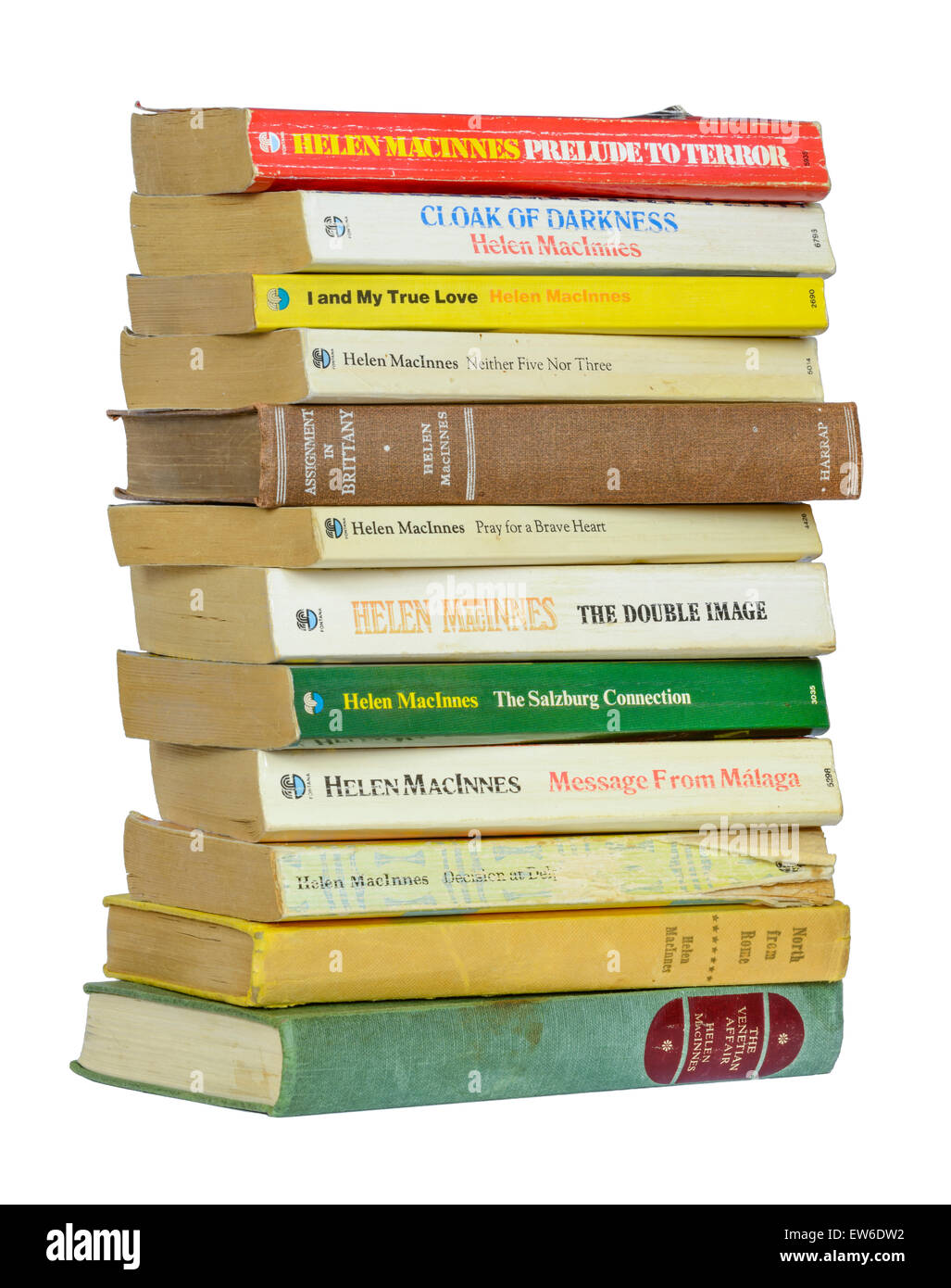 Books. Stack of old paperback books by author Helen MacInnes, on a white background. - Stock Image