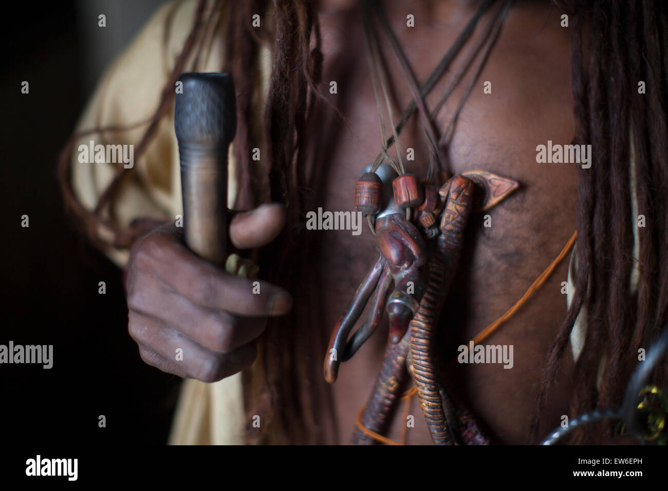 The ornamentation and pipe of a Hindu Sadhu is held in Kathmandu's Pashupatinath Temple in Nepal. - Stock Image