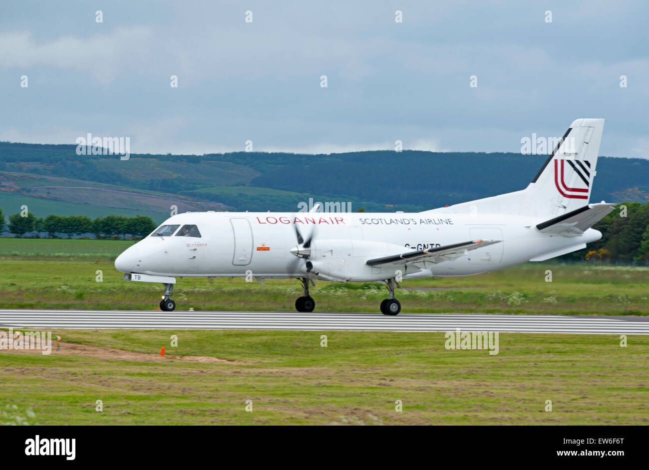 Loganair Saab 340A Scotland's Airline at Inverness Dalcross Airport.  SCO 9891. - Stock Image