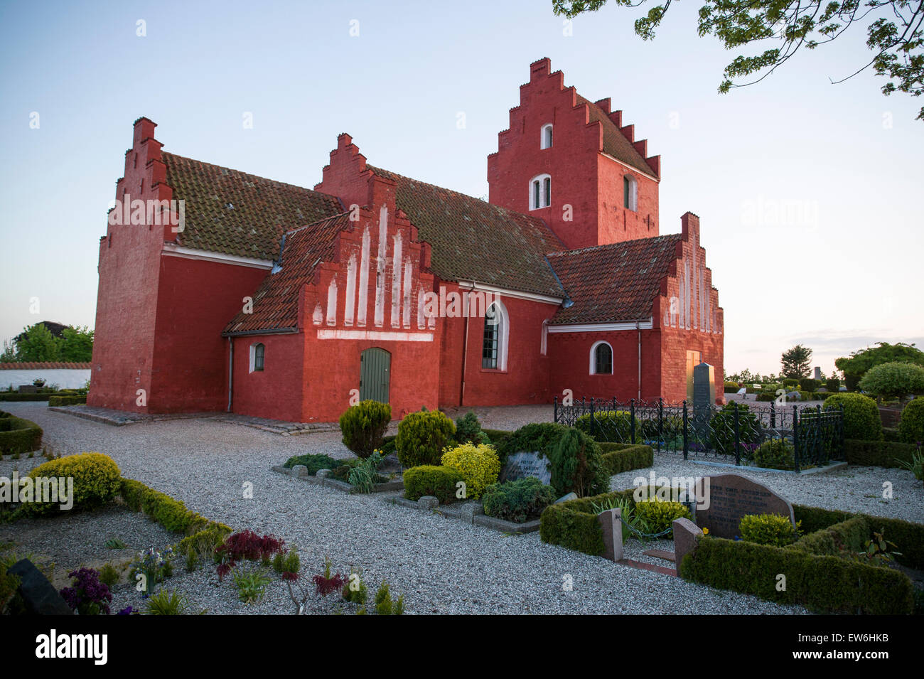 The red church near Raervig and Shelland Odds, Denmark. - Stock Image