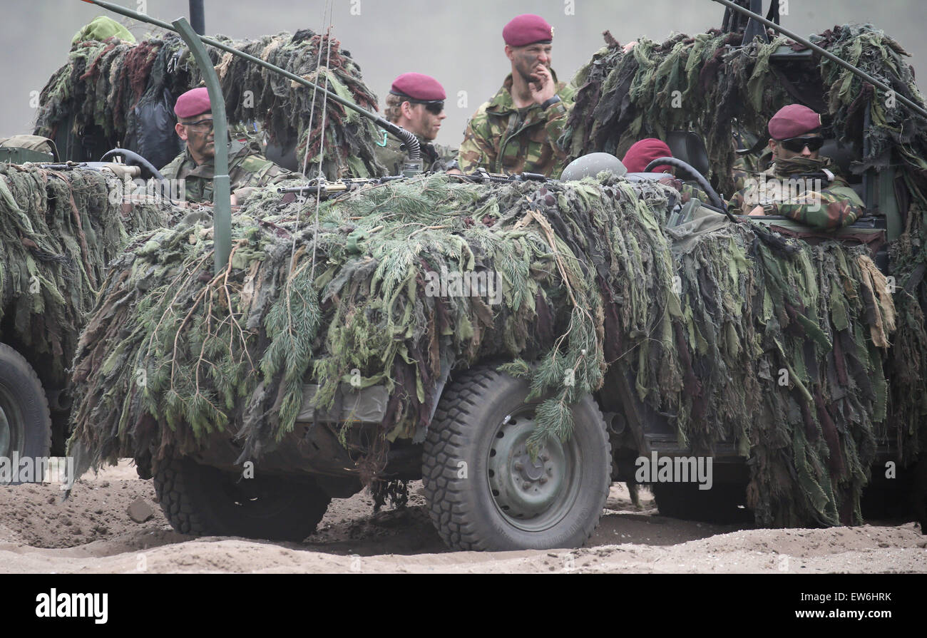 Sagan, Poland. 18th June, 2015. NATO soldiers operate in camouflaged vehicles during the first 'Noble Jump' - Stock Image