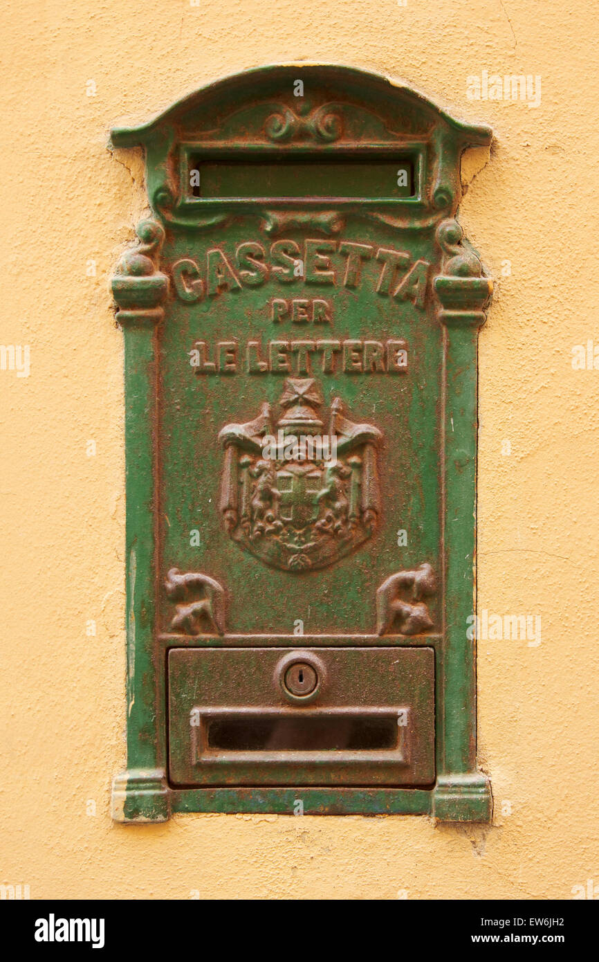 Traditional green letterbox on a yellow wall in Sassari, Sardinia - Stock Image