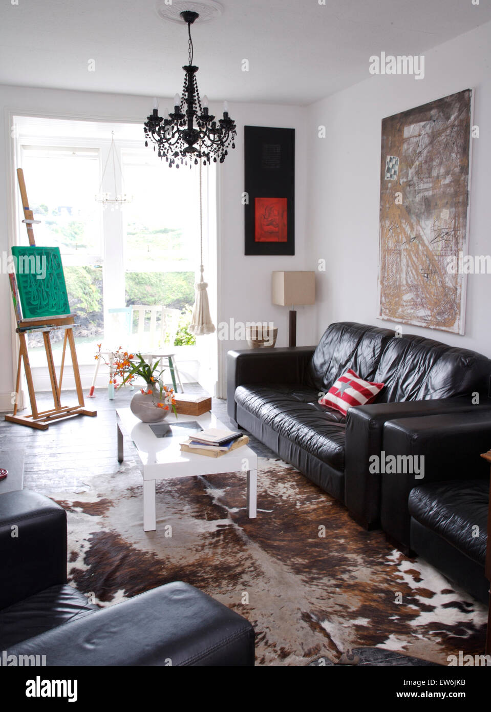 Super Black Leather Sofas And A White Coffee Table In Artists Alphanode Cool Chair Designs And Ideas Alphanodeonline