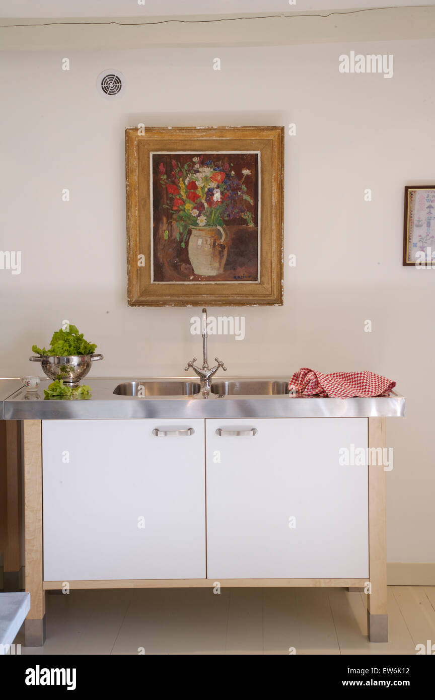 Floral Painting Above Stainless Steel Sink In Freestanding Unit In Stock Photo Alamy