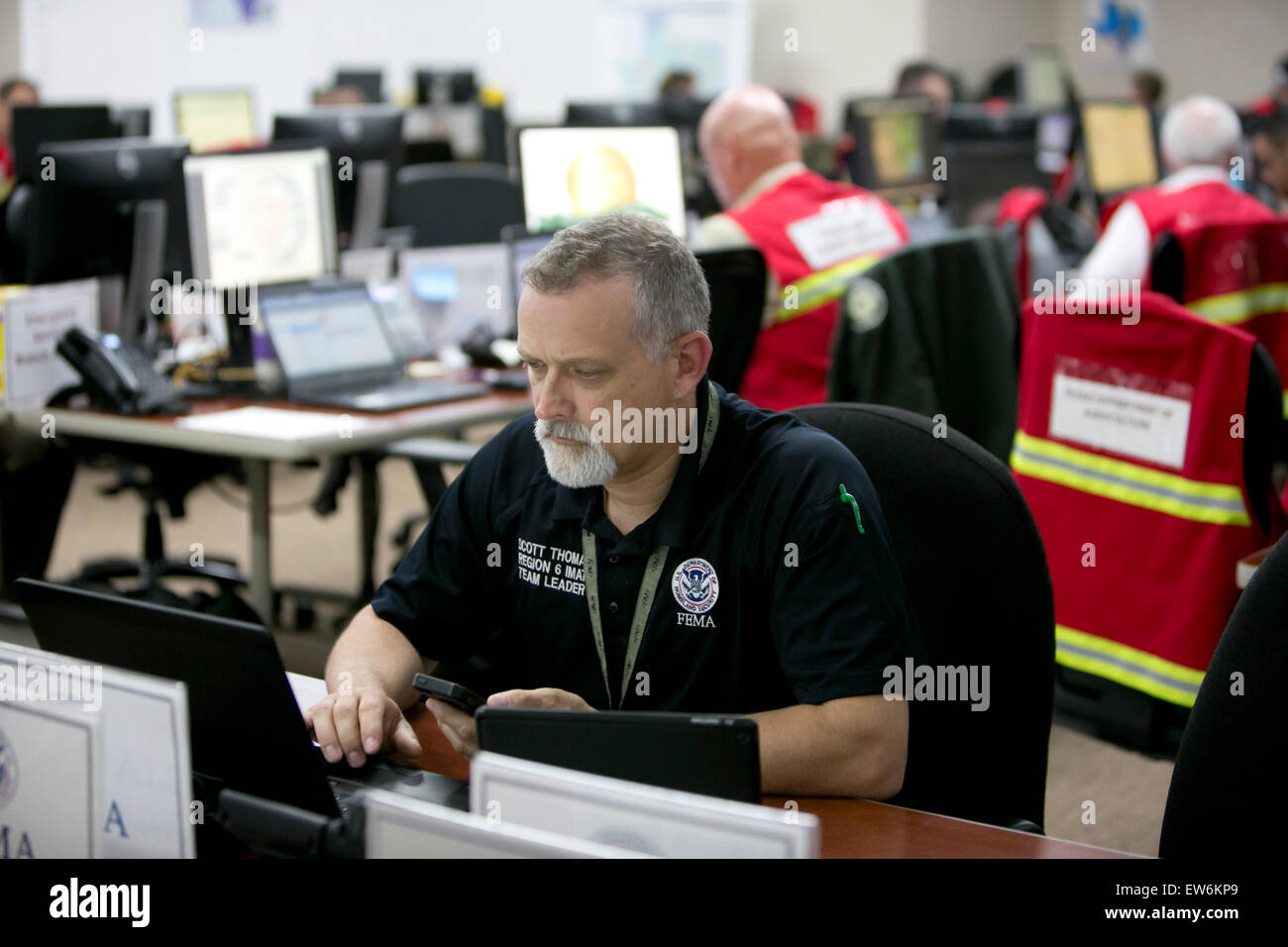 workers inside the Texas Division of Emergency Management, State Operations Center at the Texas Department of Public - Stock Image