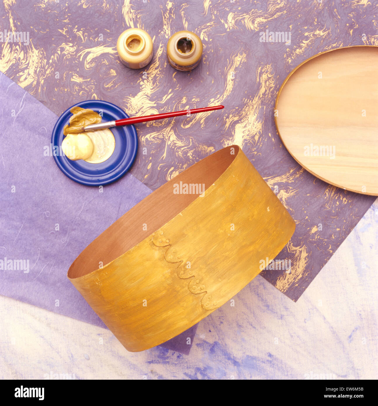 Materials for applying decoupage to a plywood box Stock Photo