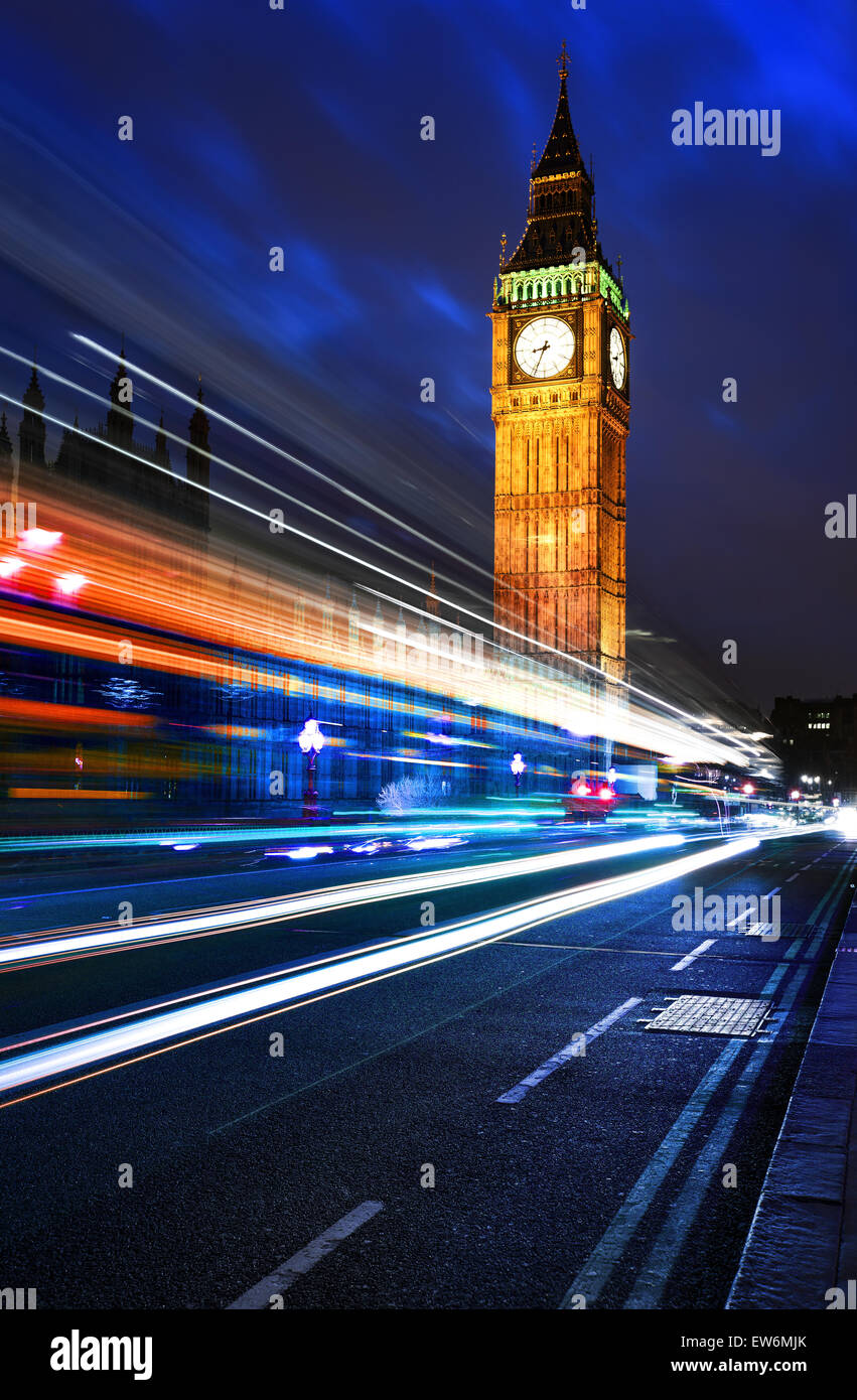 Big Ben, one of the most prominent symbols of both London and England, as shown at night along with the lights of - Stock Image