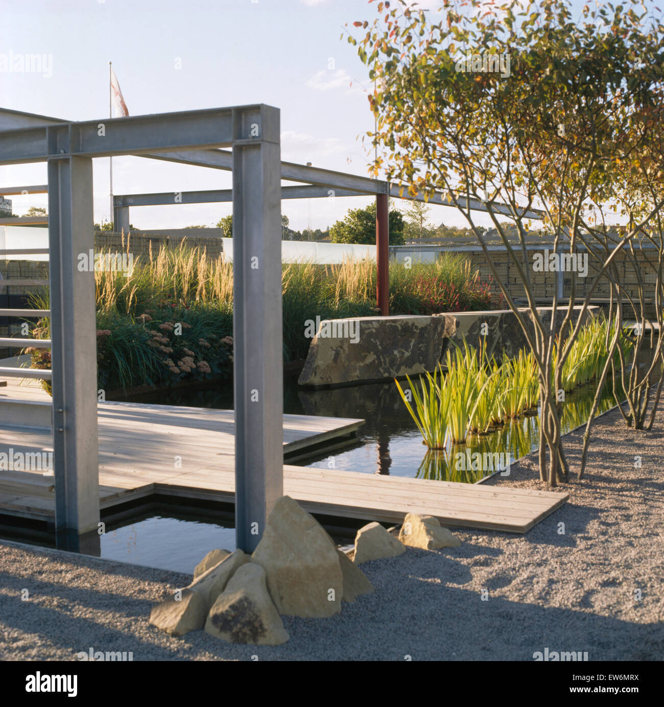 metal pergola and wooden decking in architectural garden with stock photo 84355934 alamy. Black Bedroom Furniture Sets. Home Design Ideas