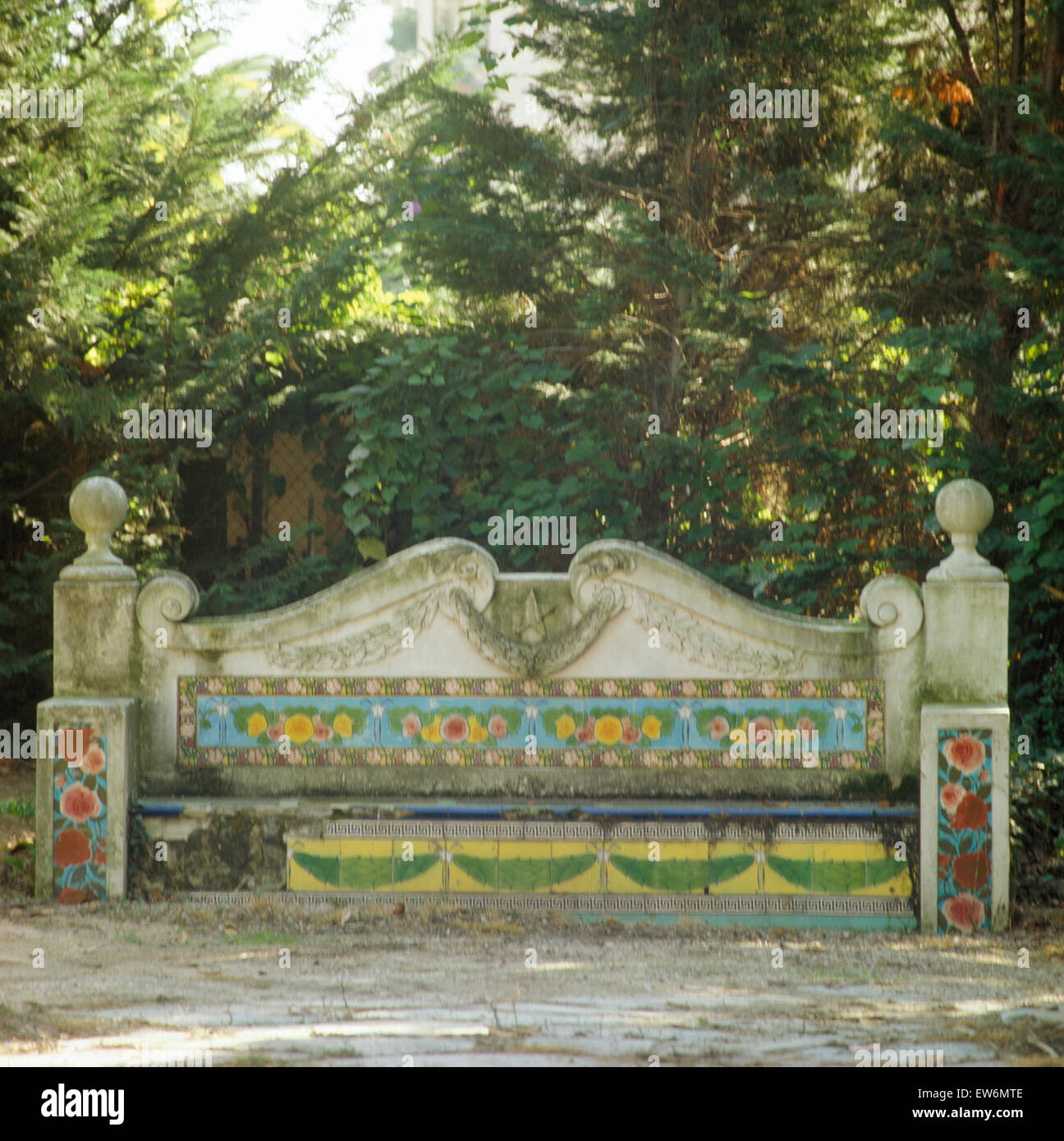 Stone Seat With Decorative Tiles In Large Italian Garden