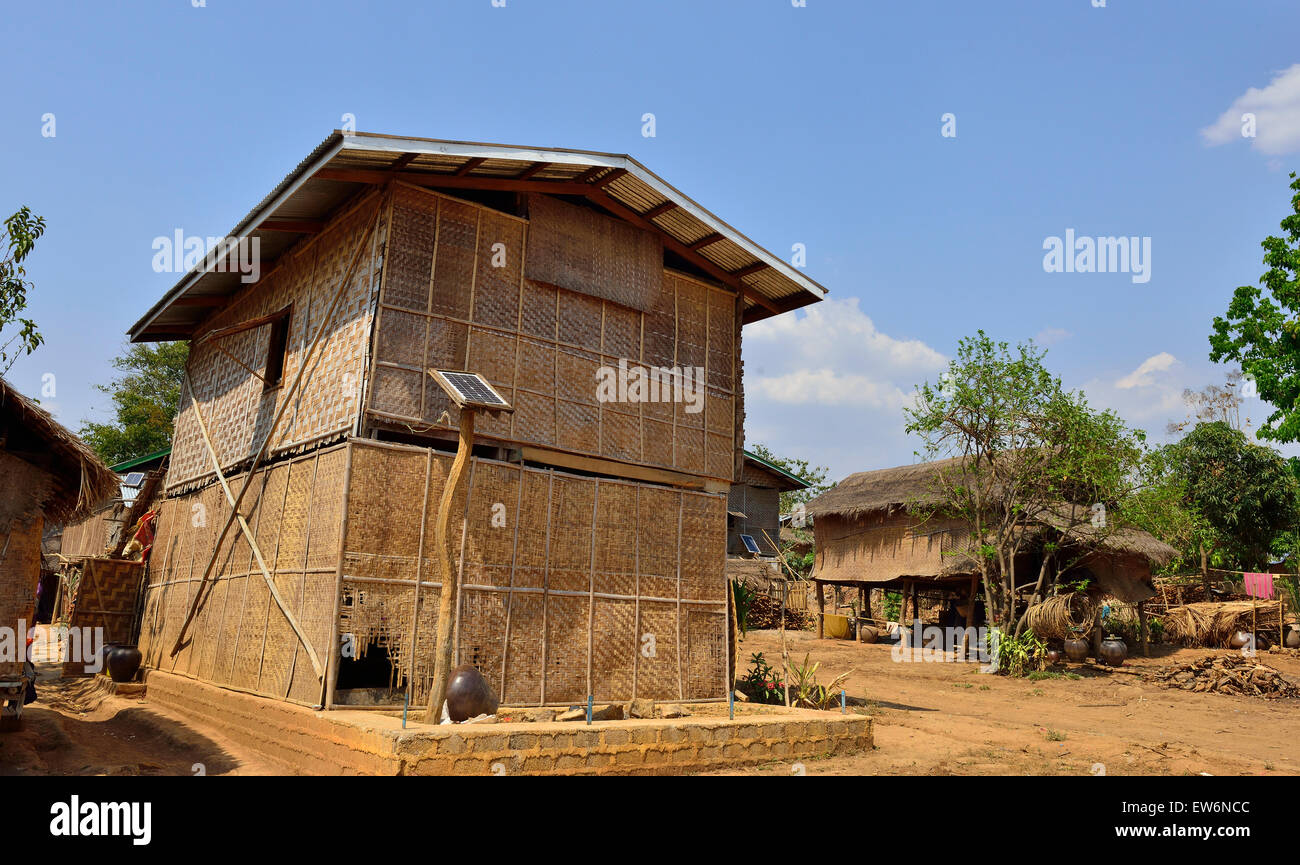 A single solar panel provides basic electricity for dwelling such as for a few lights bulbs only in village on lnle - Stock Image
