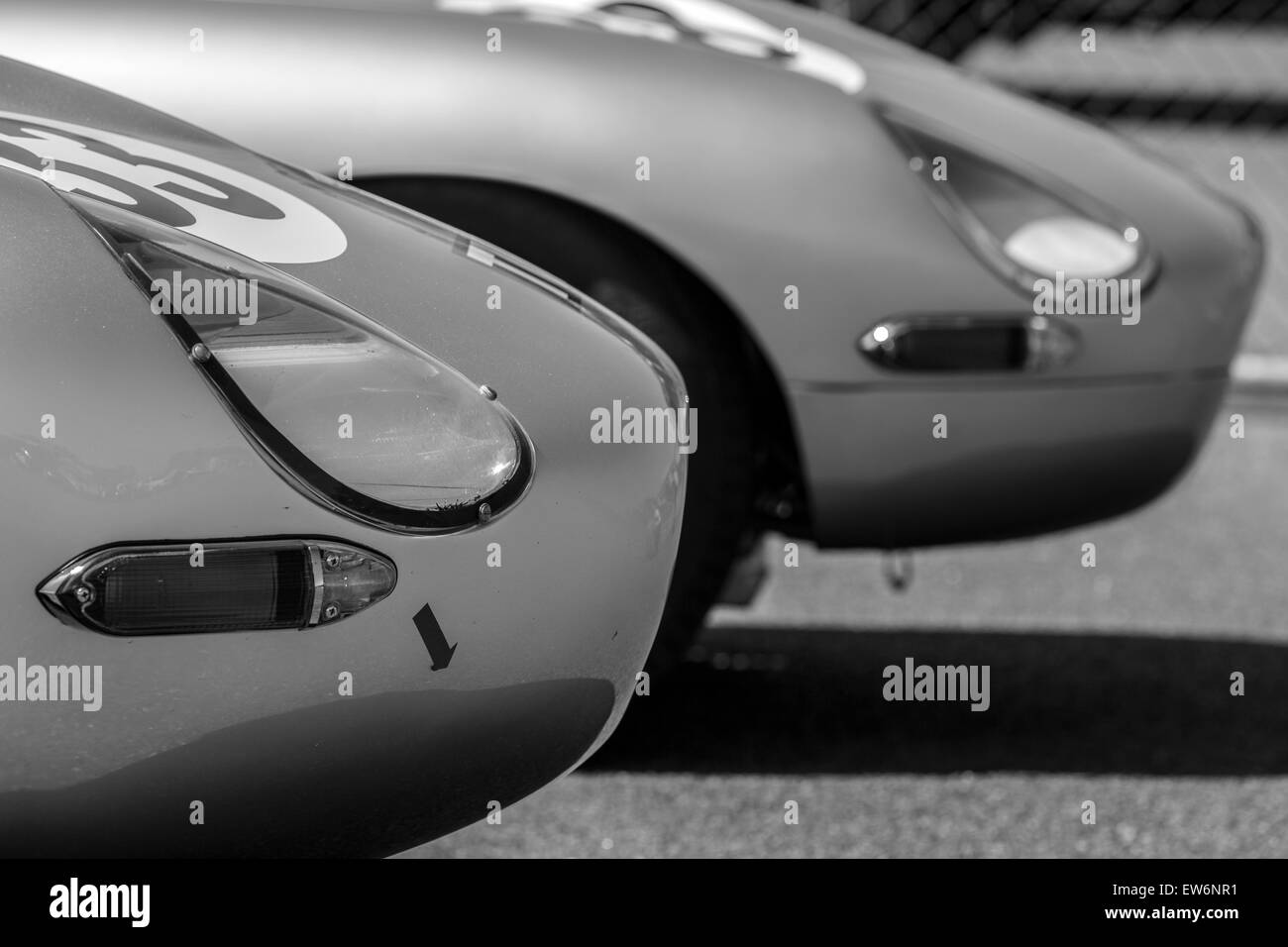 Two racing E Type Jaguars at Brands Hatch. - Stock Image