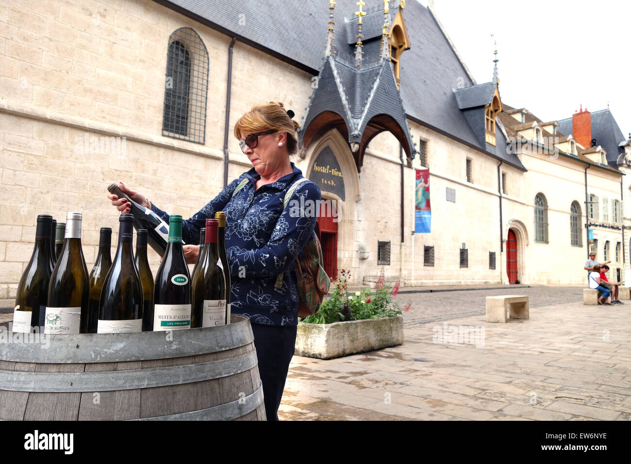 Beaune in France buying wine buyer woman - Stock Image