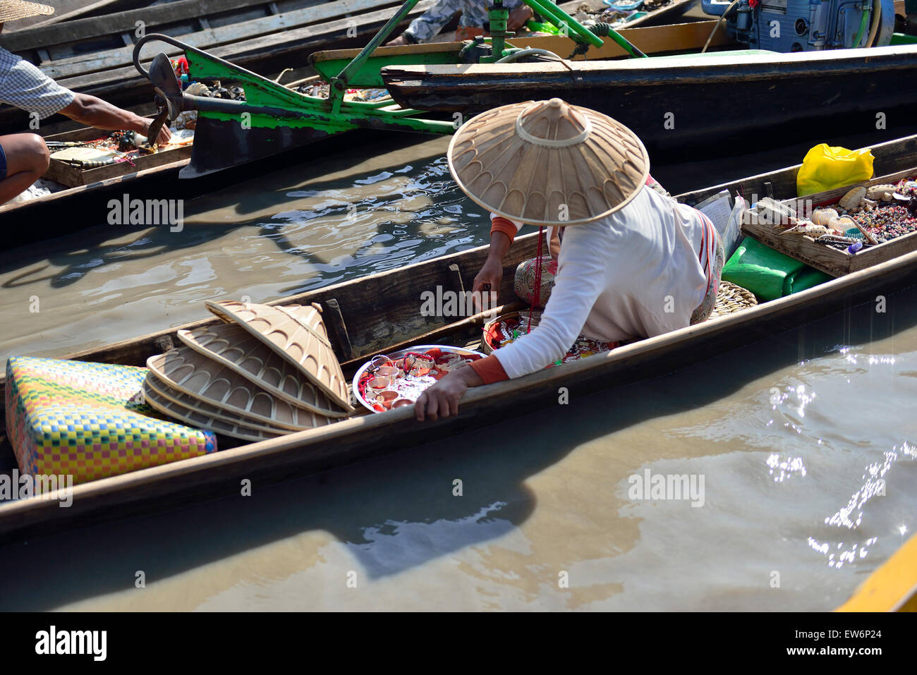 Woman on her boat selling goods at one of the 5 day rotating markets at  Nampan Market on Inle Lake,Shan State Myanmar Stock Photo