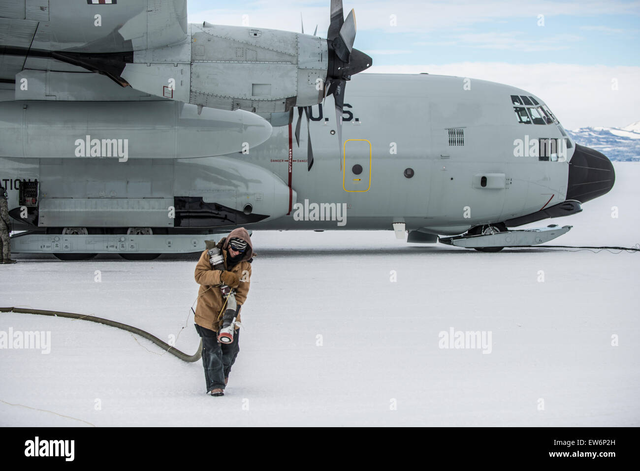 Woman Refules an USAF LC-130 at McMurdo Station, Antarctica - Stock Image