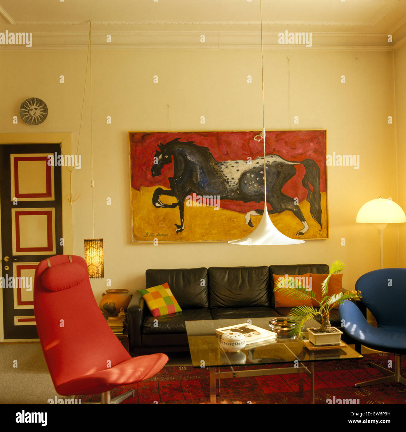 Large painting above black leather sofa in nineties ...