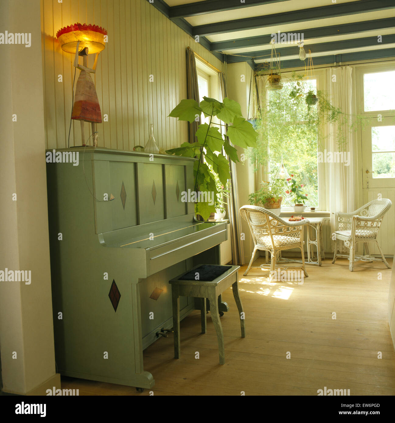 green painted furniture. Pale Green Painted Piano In Dutch Hall With Wicker Furniture And Wooden Flooring N