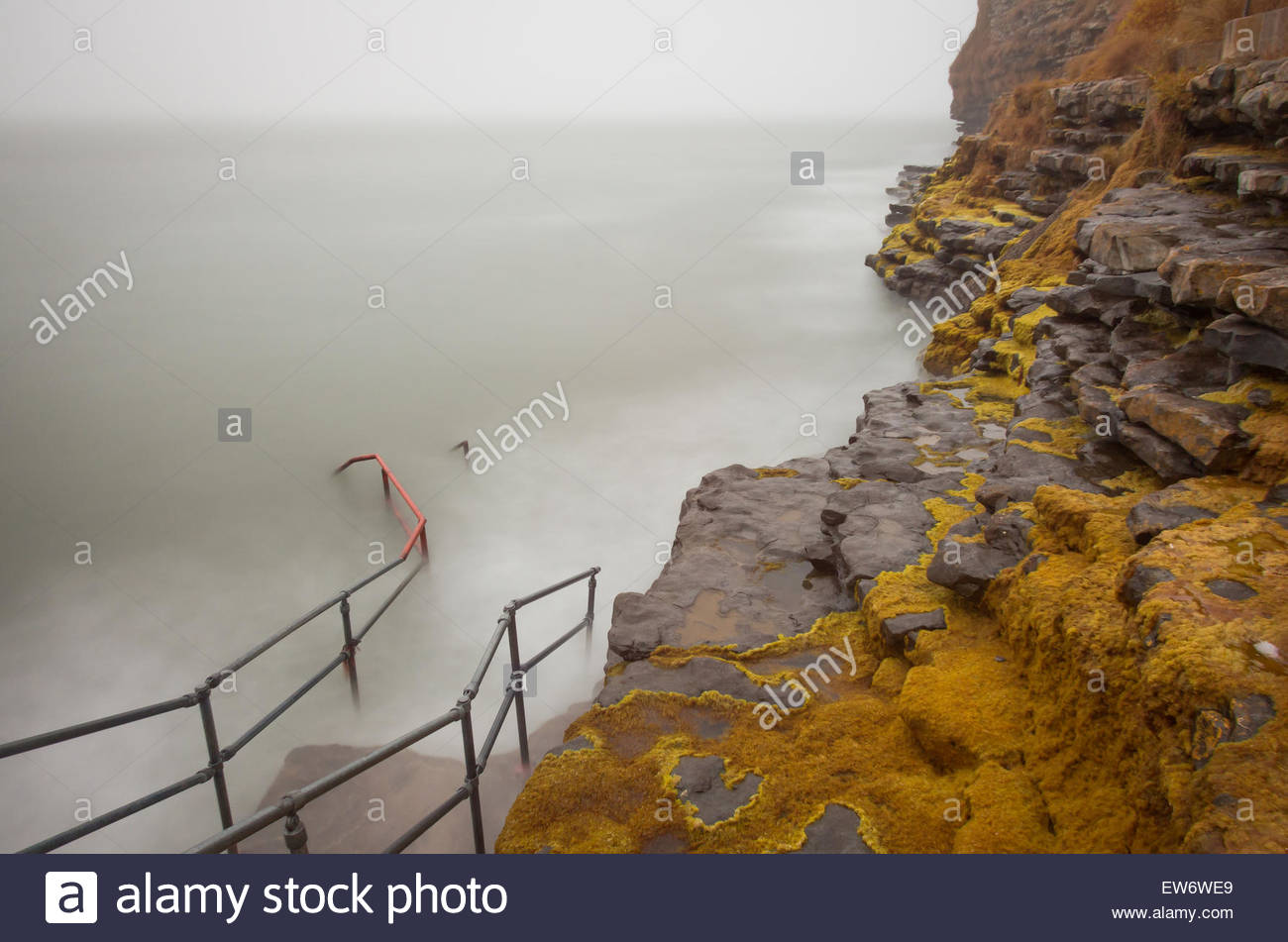 A long exposure of the steps at Porthkerry caravan park at high tide. Stock Photo