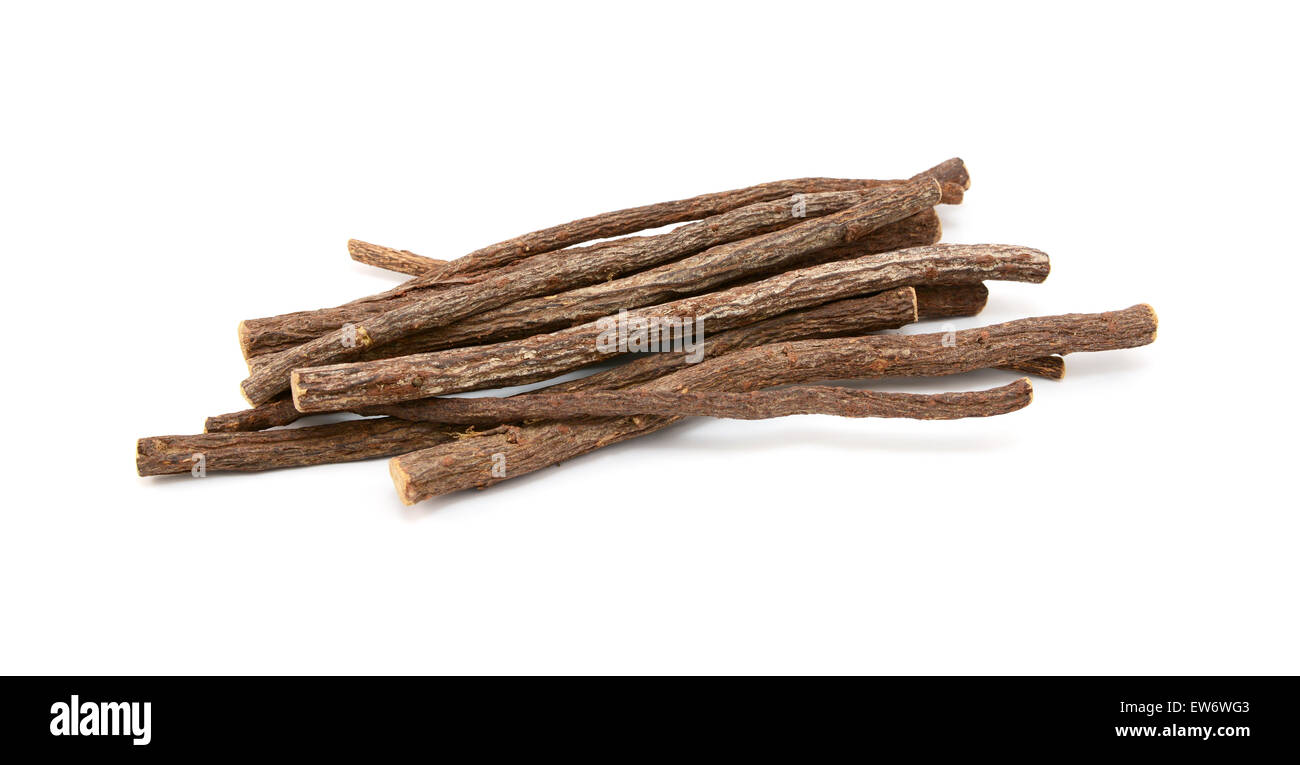 Small pile of liquorice root, isolated on a white background - Stock Image