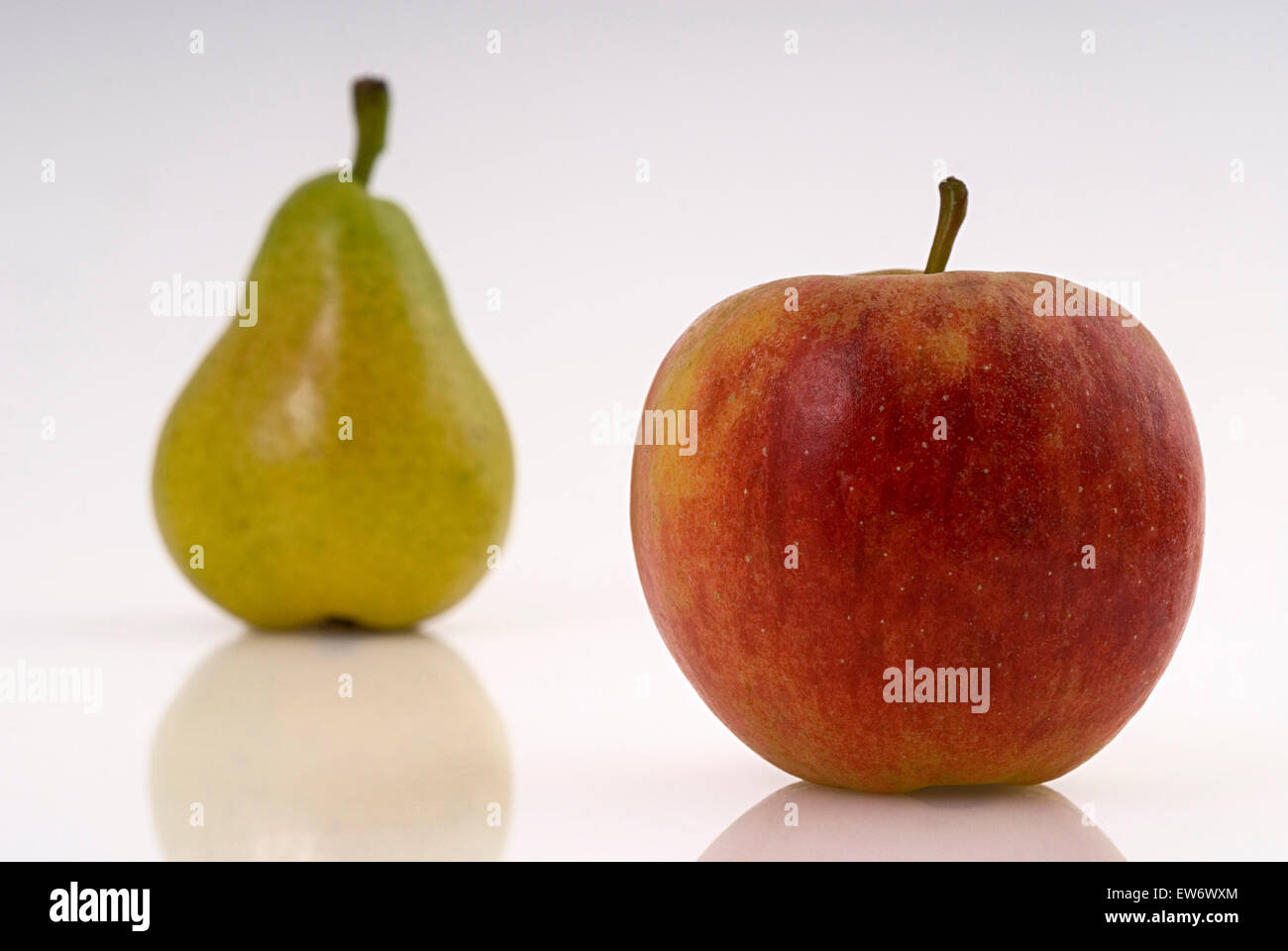Red apple and green pear food fruit fruits studio - Stock Image