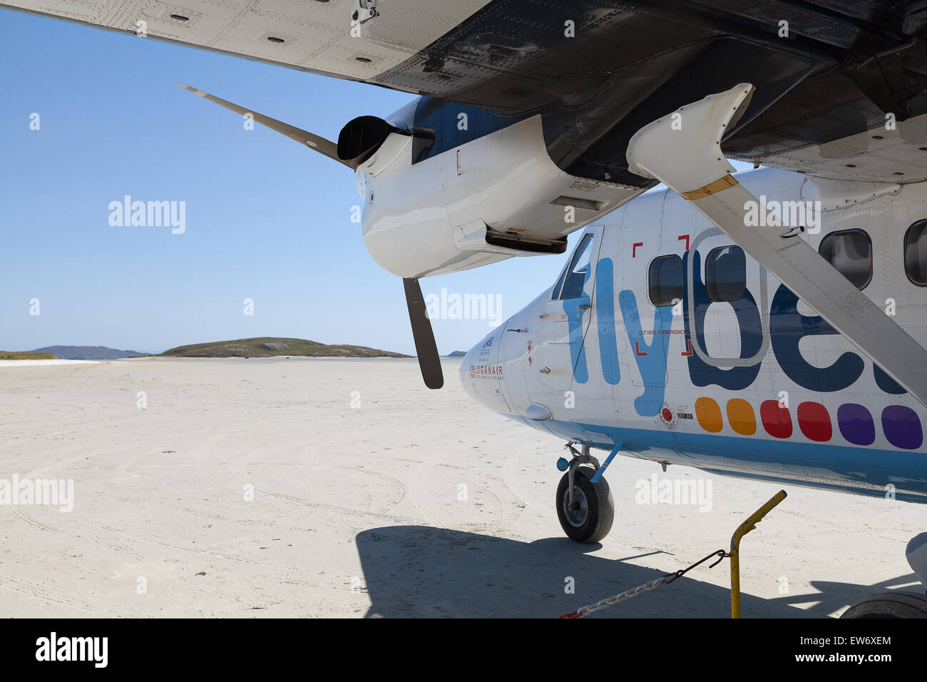Flybe airplane on the sandy runway of Barra International airport, in the Outer Hebrides of Scotland - Stock Image
