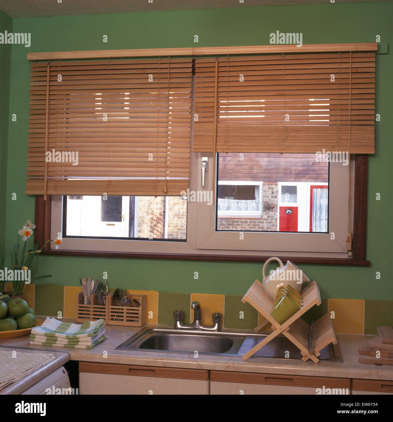 Wooden Blind On Window Above Sink In Economy Style Nineties Kitchen Stock Photo Alamy