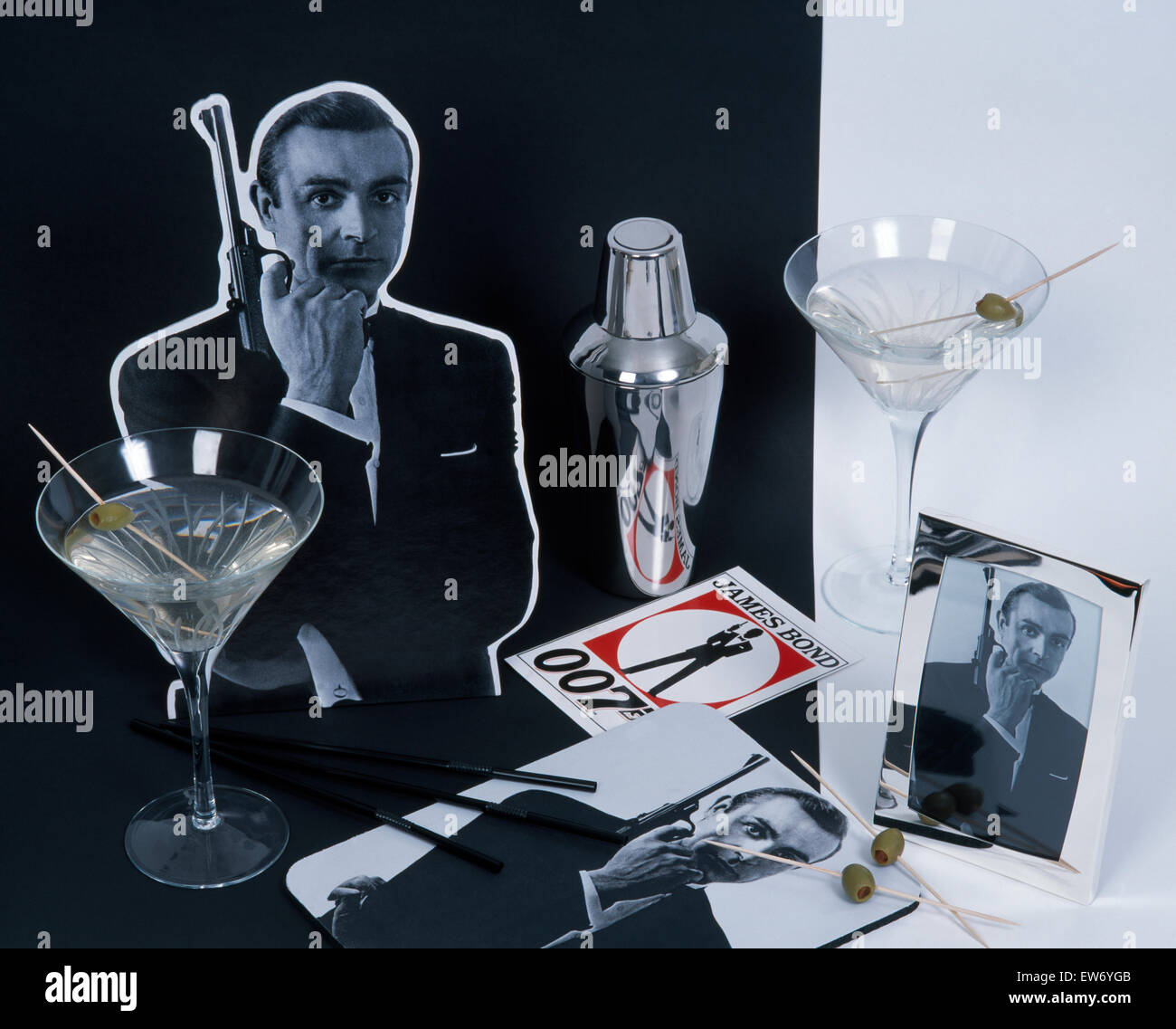 Dry Martinis in cocktail glasses with a chrome cocktail shaker in a James Bond themed tableau - Stock Image