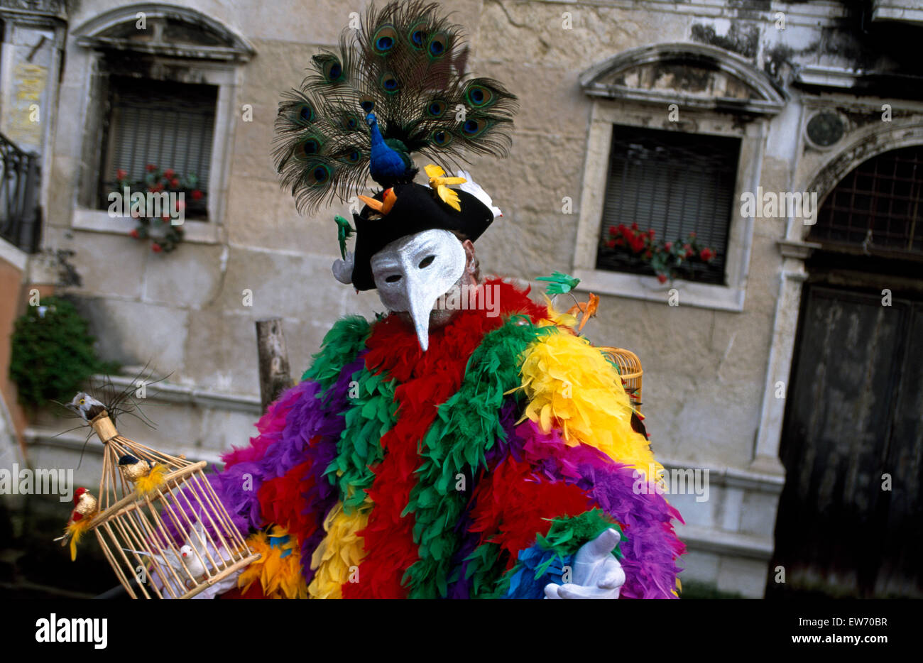 A Reveller wearing traditional mask and colorful robes at the Carnival in Venice         FOR EDITORIAL USE ONLY - Stock Image