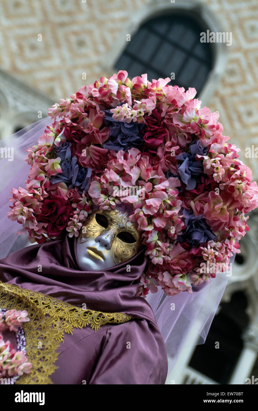 A Reveller wearing traditional mask and robes at the Carnival in Venice         FOR EDITORIAL USE ONLY - Stock Image