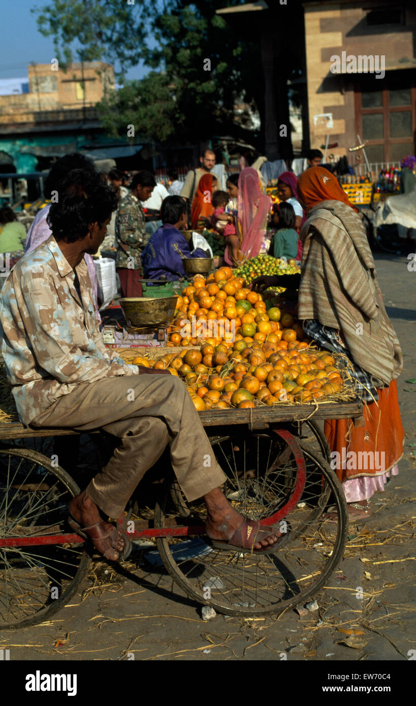 0c128591ec Vendor with a cart of oranges in an Indian street market FOR EDITORIAL USE  ONLY -