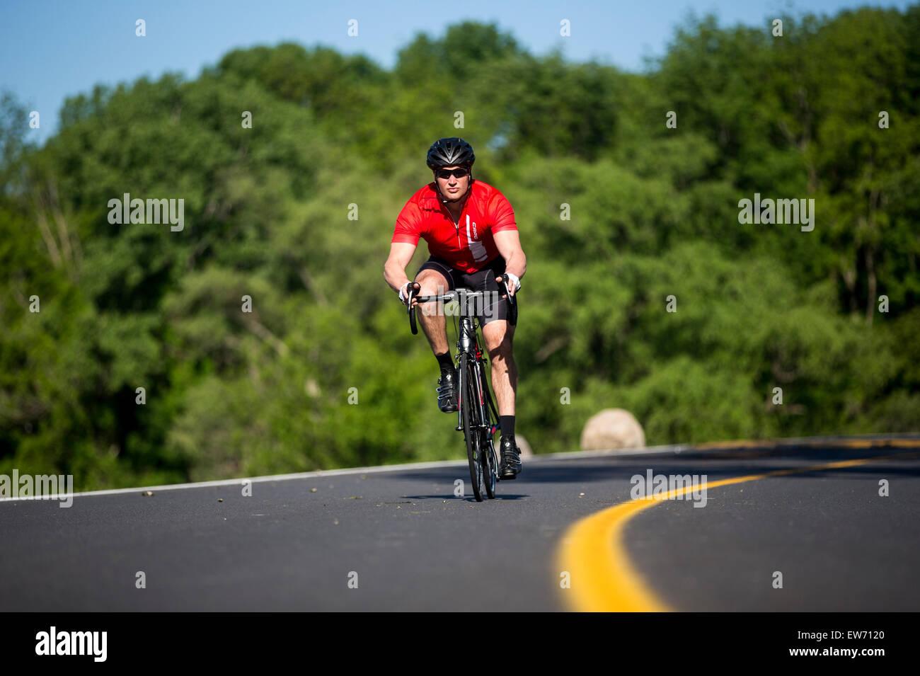 Man riding a road bike on a paved roadway Stock Photo: 84362376 - Alamy