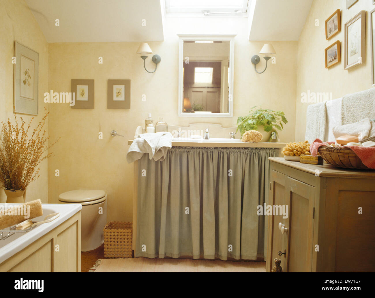 Curtains on vanity unit in small eighties bathroom extension - Stock Image
