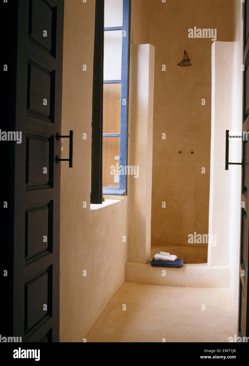 Polished concrete walls in shower in modern Moroccan bathroom Stock Photo