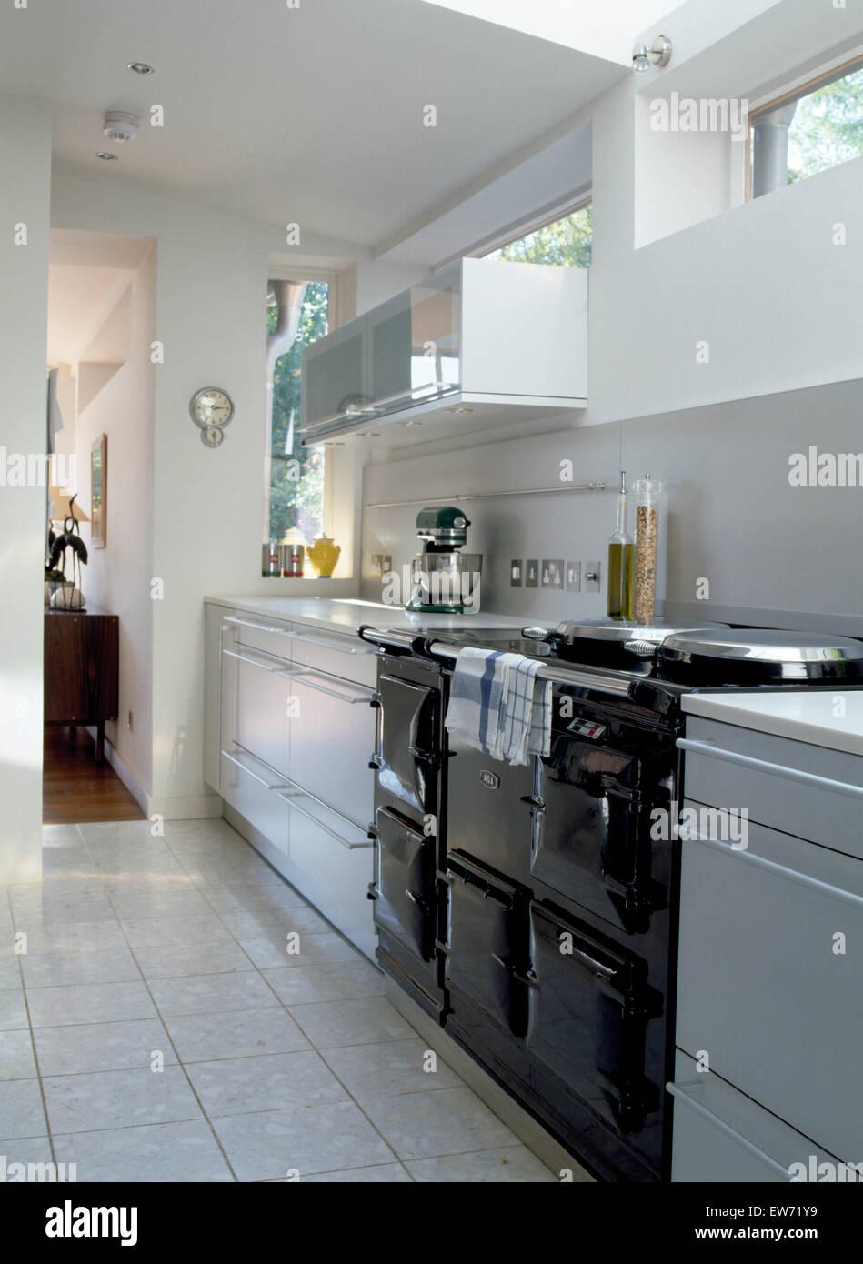 Black Aga Oven In Modern White Kitchen Extension With Chrome Mixer On Stock Photo Alamy