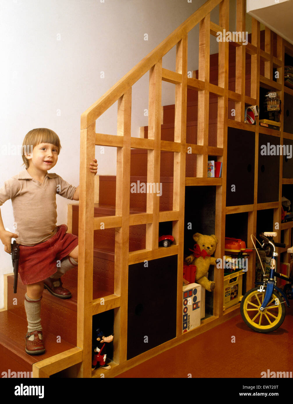 Small Boy Standing On Staircase With Under Stair Storage In A Stock Photo Alamy