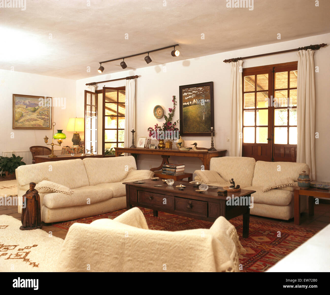 Cream Sofas And Dark Wood Coffee Table In Living Room Of Spanish