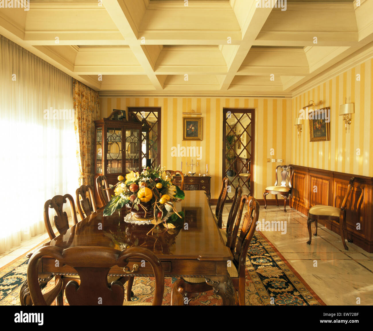 Dark Wooden Table And Chairs In Spanish Dining Room With