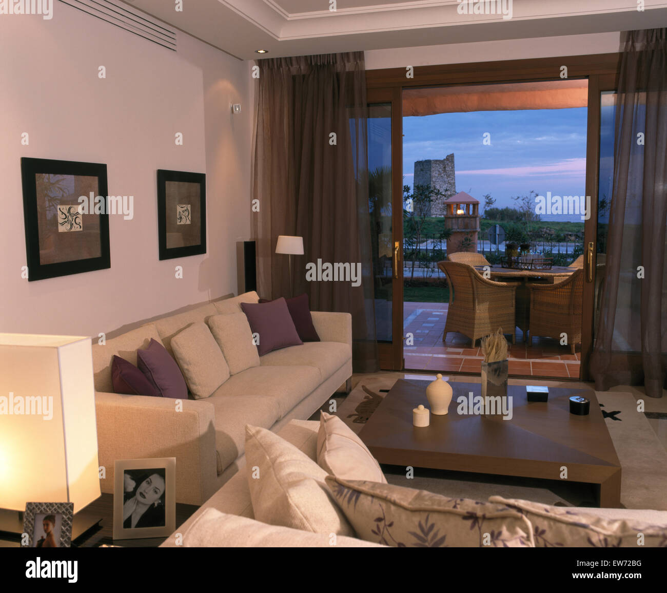 White Sofas In Spanish Living Room With Brown Voile Drapes
