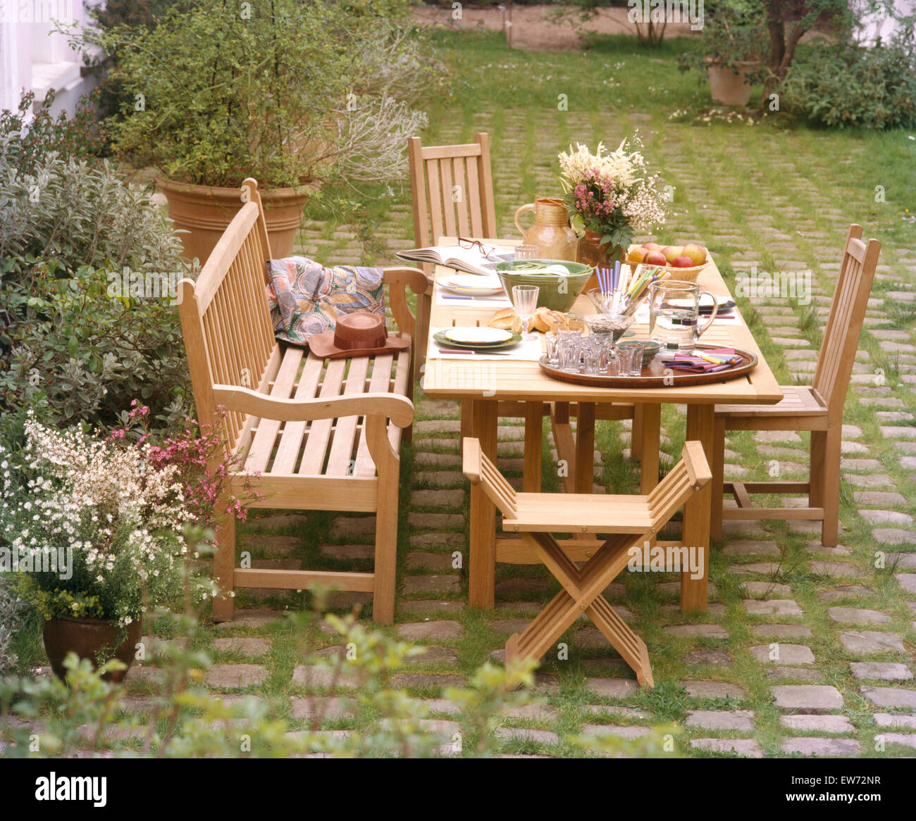 Brilliant Wooden Bench And Chairs At Table Set For Lunch On Patio In Pabps2019 Chair Design Images Pabps2019Com